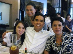 with her tita sheila (+), tito joseph and mother (my sister jovy)